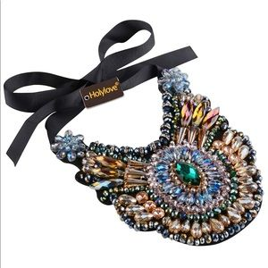 Beautiful necklace with so much detail. Ribbon tie
